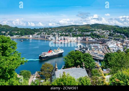 Caledonian Macbrayne car and passenger ferry Isle of Mull arriving at the berth in harbour Oban Argyll & Bute Scotland from Mull - Stock Photo