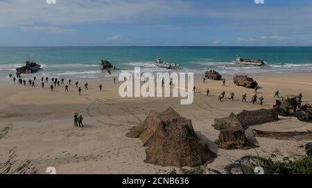 Soldiers from the Australian Army's 3rd Brigade march across Langham Beach after an amphibious assault landing during the Talisman Saber joint military exercises between Australia and the United States in Queensland,  northeast Australia, July 13, 2017.  REUTERS/Jason Reed - Stock Photo