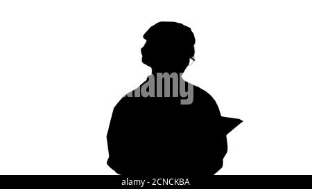 Silhouette Young positive doctor woman taking notes on tablet an - Stock Photo