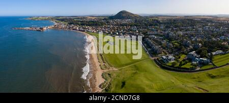 Aerial panoramic view of the West Links and town centre, North Berwick, East Lothian, Scotland.