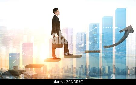 Business man climbing up stair steps to career success with business district and horizon skyline as background. Concept of business goal success - Stock Photo