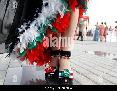The shoes of Katharina Dietrich of Germany are seen as she poses for a photo ahead of the 17th Dubai World Cup at the Meydan racecourse in Dubai March 31, 2012. The Dubai World Cup, with a cash prize of $10 million, is horse racing's richest race. REUTERS/Jumana El Heloueh (UNITED ARAB EMIRATES - Tags: SPORT HORSE RACING SOCIETY) - Stock Photo