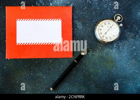 Pocket watch made in USSR, pencil and letter, high angle view - Stock Photo