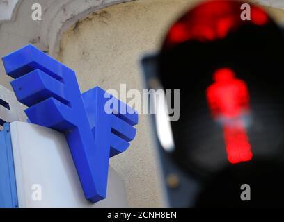 A Volksbank logo is seen behind traffic lights in Vienna, Austria, June 28, 2016. REUTERS/Heinz-Peter Bader