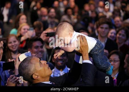 U.S. President Barack Obama holds Rowan Wright, after speaking at the White House Frontiers Conference in Pittsburgh, U.S. October 13, 2016.  REUTERS/Carlos Barria - Stock Photo