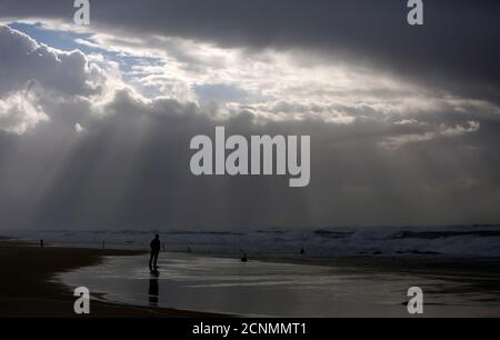 A person stands on the shores of the Mediterranean Sea on a stormy day at Nitzanim beach, near the southern city of Ashkelon, January 7, 2013. REUTERS/Amir Cohen (ISRAEL - Tags: ENVIRONMENT TRAVEL TPX IMAGES OF THE DAY)