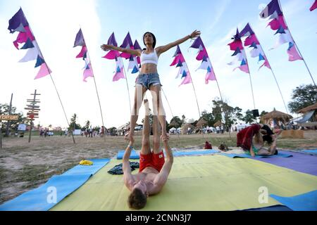 People do yoga at Wonderfruit art festival in Pattaya, Thailand, December 15, 2018. REUTERS/Ann Wang - Stock Photo
