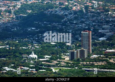 Residential buildings and houses are seen from the San Salvador Volcano in San Salvador, El Salvador September 24, 2018. REUTERS/Jose Cabezas - Stock Photo