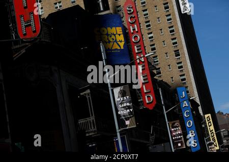 A row of closed theatres are seen in the Broadway district due the outbreak of the coronavirus disease (COVID-19) in Manhattan, New York City, U.S., May 15, 2020. REUTERS/Andrew Kelly - Stock Photo