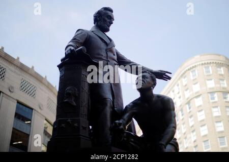 The Emancipation Memorial, a statue depicting U.S. President Abraham Lincoln standing over a freed slave that has become controversial for some activists during protests against racial inequality in the aftermath of the death in Minneapolis police custody of George Floyd, stands in Boston, Massachusetts, U.S., June 23, 2020.   REUTERS/Brian Snyder - Stock Photo