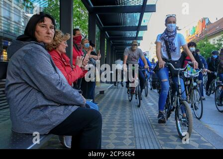 Protesters wearing protective masks ride bicycles during an anti-government protest, as the spread of the coronavirus disease (COVID-19) continues, in Ljubljana, Slovenia May 8, 2020. REUTERS/Borut Zivulovic - Stock Photo