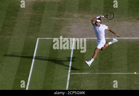 Roger Federer of Switzerland hits a return during his men's singles semi-final tennis match against Milos Raonic of Canada at the Wimbledon Tennis Championships, in London July 4, 2014.           REUTERS/John Walton/Pool (BRITAIN  - Tags: SPORT TENNIS) - Stock Photo