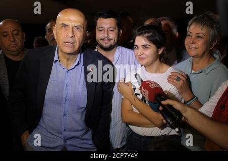 Enis Berberoglu, the first lawmaker from the main opposition Republican People's Party (CHP) to be jailed amid government purges following a failed military coup in 2016, reacts as he is flanked by his wife Oya (R) and his daughter Dilara after being released from the prison in Silivri near Istanbul, Turkey, September 20, 2018. REUTERS/Huseyin Aldemir