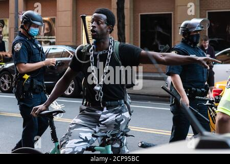 A protestor is upset as his brother is arrested by NYPD offiicers during a demonstration against Immigration and Customs Enforcement in New York City on September 18, 20202. For a third day in a row, protestors demonstrated against alleged accusations that a physician perfomed medically unnecessary hysterectomies on undocumented women in I.C.E. custody. (Photo by Gabriele Holtermann/Sipa USA) Credit: Sipa USA/Alamy Live News - Stock Photo