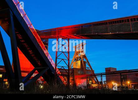 UNESCO world heritage site Zeche Zollverein illuminated in the evening, Essen, Ruhr area, North Rhine-Westphalia, Germany - Stock Photo
