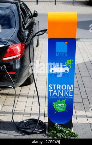 Electric car refueling electric power at a charging station, Monheim am Rhein, North Rhine-Westphalia, Germany