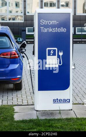 Electric car refueling electricity at a Steag charging station, Essen, Ruhr area, North Rhine-Westphalia, Germany