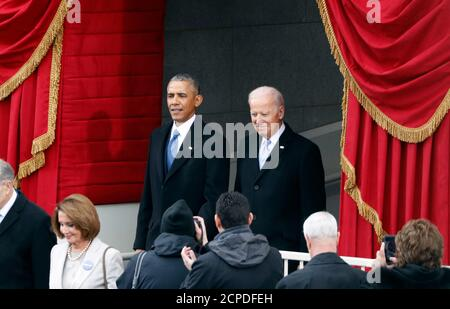 US President Barack Obama and Vice President Joe Biden attend the inauguration ceremonies to swear in Donald Trump as the 45th president of the United States at the U.S. Capitol in Washington, U.S., January 20, 2017.  REUTERS/Lucy Nicholson