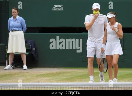 Tennis - Wimbledon - London, Britain - July 16, 2017   Great Britain's Jamie Murray and Switzerland's Martina Hingis during their mixed doubles final against Finland's Henri Kontinen and Great Britain's Heather Watson    REUTERS/Toby Melville - Stock Photo