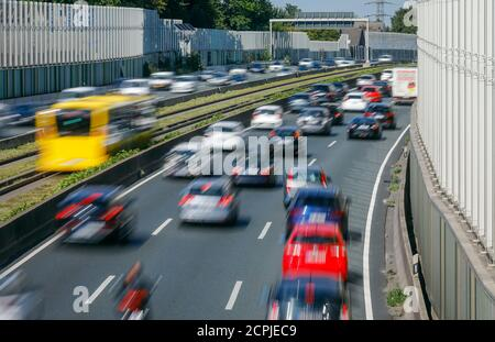Essen, Ruhr area, North Rhine-Westphalia, Germany - Many cars drive on the A40 motorway during rush hour traffic, a noise barrier reduces the noise - Stock Photo