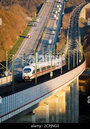 ICE train of the Deutsche Bahn AG runs on the high-speed line Cologne-Frankfurt, in the back cars and trucks drive on the A3 motorway, Neustadt Wied,