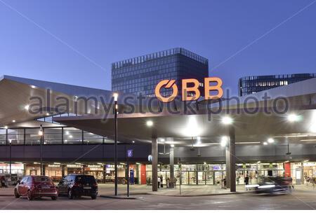 OBB - Österreichische Bundesbahnen, Wien Hauptbahnhof, main railway station entrance at dusk located in the Favoriten district of Vienna Austria. - Stock Photo