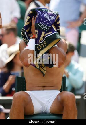 Tennis - Wimbledon - All England Lawn Tennis and Croquet Club, London, Britain - July 7, 2018  Spain's Rafael Nadal changes his shirt during the third round match against Australia's Alex De Minaur  REUTERS/Andrew Boyers - Stock Photo