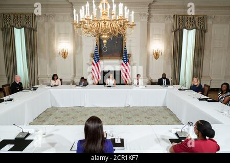 Washington, United States Of America. 14th Sep, 2020. First Lady Melania Trump listens as Shamonica Wiggins, a sickle cell disease patient and advocate, delivers remarks during a roundtable on Improving the Lives of Americans Living with Sickle Cell Disease Monday, Sept. 14, 2020, in the State Dining Room of the White House People: First Lady Melania Trump Credit: Storms Media Group/Alamy Live News - Stock Photo