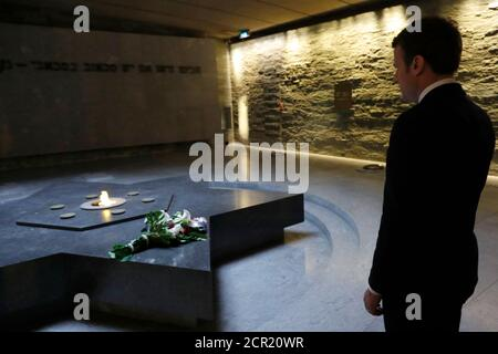 Emmanuel Macron, head of the political movement En Marche !, or Onwards !, and candidate for the 2017 presidential election, visits the Shoah Memorial in Paris, France, April 30, 2017. REUTERS/Philippe Wojazer