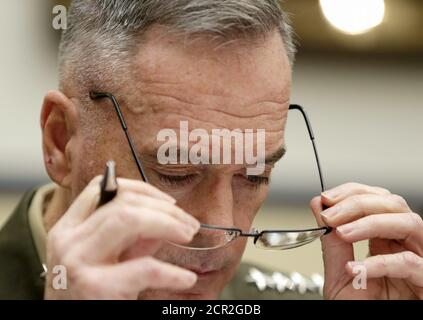 U.S. Joint Chiefs Chairman Marine Corps Gen. Joseph Dunford Jr., testifies before a House Armed Services Committee hearing on 'U.S. Strategy for Syria and Iraq and its Implications for the Region' in Washington December 1, 2015.   REUTERS/Gary Cameron - Stock Photo