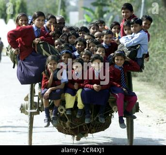 ATTENTION EDITORS - 15 OF 21 PICTURES TO MATCH PACKAGE 'WORLD POPULATION - SEVEN BILLION' -  TO FIND ALL PICTURES SEARCH 'POPULATION-BABY/'  Indian children ride in a cart on the way home from school in the outskirts of New Delhi in this file picture taken, February 26, 2001.  The world?s population will reach seven billion on 31 October 2011, according to projections by the United Nations, which says this global milestone presents both an opportunity and a challenge for the planet. While more people are living longer and healthier lives, says the U.N., gaps between rich and poor are widening