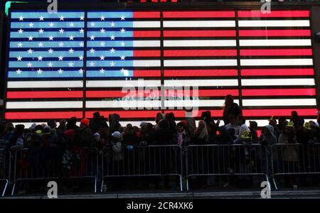 People watch as floats make their way through Times Square during the 85th annual Macy's Thanksgiving day parade in New York November 24, 2011. REUTERS/Shannon Stapleton (UNITED STATES - Tags: SOCIETY) - Stock Photo