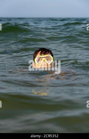 Germany, Mecklenburg-Western Pomerania, Ruegen Island, Baltic Sea resort Binz, boy with diving goggles, Baltic Sea