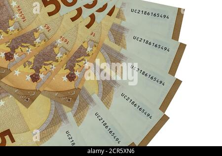 50 euro bills lies isolated on white background with copy space stacked in fan shape close up. Financial transactions concept
