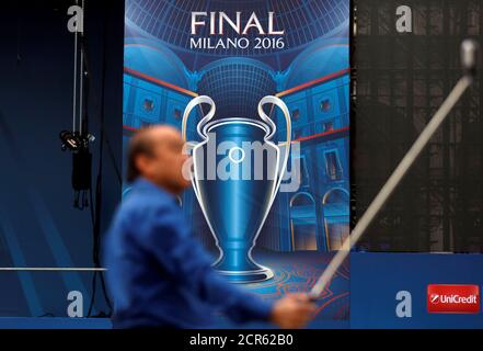 A tourist takes a selfie picture in front of a big screen stage of the UEFA Champions League Final 2016 in Duomo's square downtown Milan, Italy, May 23, 2016. REUTERS/Stefano Rellandini
