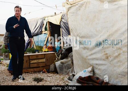 Prime Minister David Cameron visits a Syrian refugee settlement camp in the Bekaa Valley in Lebanon, September 14, 2015. British Prime Minister David Cameron arrived in Beirut on Monday to visit refugees from the war in neighbouring Syria, which has driven well over a million people into Lebanon and tens of thousands towards Europe, Lebanese media reported. Cameron will visit refugees and then meet with his Lebanese counterpart Tammam Salam. Lebanon, where one in every four people is a refugee, is hosting the greatest number of refugees per capita of any country in the world. It has called on