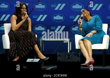 U.S. First Lady Michelle Obama and television presenter Oprah Winfrey participate in the White House's 'United State of Women' summit in Washington, U.S. June 14, 2016. REUTERS/Jonathan Ernst - Stock Photo
