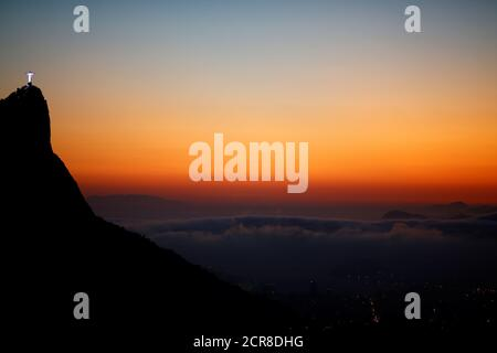 Christ the Redeemer is seen from the Vista Chinesa (Chinese View) during sunrise in Rio de Janeiro, Brazil, May 4, 2016. REUTERS/Ricardo Moraes SEARCH 'RIO POSTCARDS' FOR THIS STORY. SEARCH 'THE WIDER IMAGE' FOR ALL STORIES.    TPX IMAGES OF THE DAY - Stock Photo
