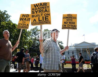 Protesters rally against proposed U.S. military action in Syria as they gather in front of the White House in Washington, September 7, 2013. REUTERS/Jonathan Ernst   (UNITED STATES - Tags: POLITICS CIVIL UNREST) - Stock Photo