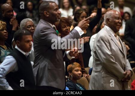 Michael Brown's mother Lesley McSpadden (seated) watches veteran civil rights activist Rev. Al Sharpton speak at the Friendly Temple Missionary Baptist Church in St. Louis, Missouri November 30, 2014. Sharpton preached on Sunday to a congregation of some 2,500 worshippers at the St. Louis church where Michael Brown's funeral was held in August. The dead teen's parents were among the congregation.  REUTERS/Adrees Latif  (UNITED STATES - Tags: CRIME LAW CIVIL UNREST POLITICS RELIGION)