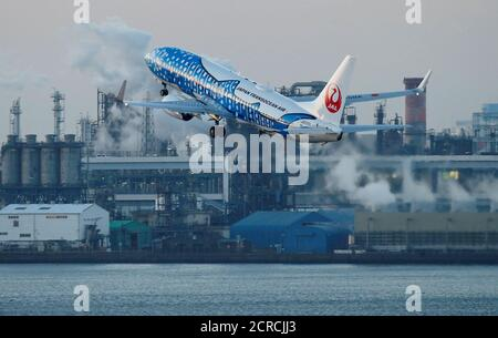 Japan Transocean Air (JTA), Japan Airlines (JAL) group, Boeing 737-400 painted in special livery takes off from the Tokyo International Airport, commonly known as Haneda Airport, in Tokyo, Japan January 10, 2018.  REUTERS/Toru Hanai