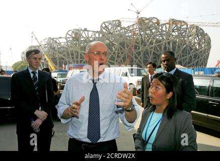 U.S. Treasury Secretary Henry Paulson (C) tours the construction site of China's National Stadium, where the opening ceremony of the 2008 Olympic Games will be held, in Beijing September 21, 2006. Paulson on Thursday urged China to open its financial sector to foreign competition and said a critical challenge would be to hold back global trade protectionist forces.  REUTERS/Greg Baker/Pool  (CHINA) - Stock Photo