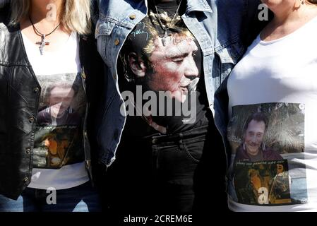 Fans wear shirts with the portrait of Johnny Halliday as thousands gather outside the La Madeleine church to celebrate the 75th anniversary of the late French singer Johnny Hallyday in Paris, France, June 15, 2018.  REUTERS/Charles Platiau - Stock Photo