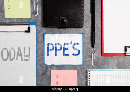 Word writing text Ppe s is. Business photo showcasing Specialized equipment for protection against health and safety hazard Paper accesories with digi - Stock Photo
