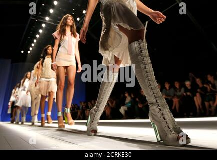 Models walk down the runway at the end of Just Cavalli's Spring/Summer 2013 collection at Milan Fashion Week September 21, 2012. REUTERS/Stefano Rellandini(ITALY - Tags: FASHION)