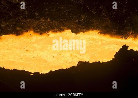 Molten cast iron is seen inside blast-furnace number six at the Novolipetsk (NLMK) steel mill in Lipetsk, Russia, August 3, 2015. REUTERS/Maxim Shemetov