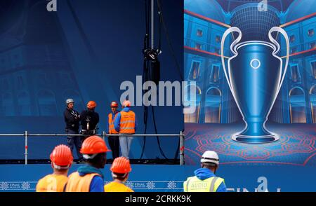 Workers are seen on the big screen stage of the UEFA Champions League Final 2016 in Duomo's square downtown Milan, Italy, May 23, 2016. REUTERS/Stefano Rellandini