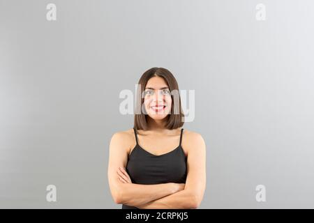 Young beautiful Turkish woman view in confident mood, isolated studio shot with copy space - Stock Photo