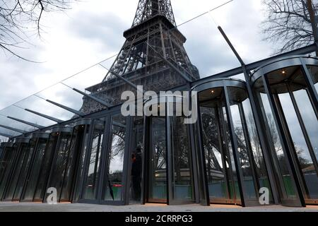 New control glass gates are seen at the bottom of the Eiffel Tower in Paris, France, March 31, 2018. REUTERS/Gonzalo Fuentes - Stock Photo
