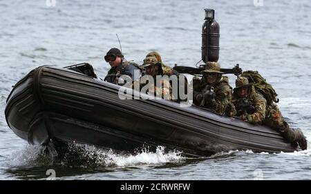 Members of German Navy Special Operations Forces use a speedboat during an exercise in the Baltic Sea near the northern German town of Eckernfoerde, July 1, 2004. The German Navy Special Operations Forces of the German Armed Forces Bundeswehr whose membership of which is kept secret, are chiefly involved in military operations. REUTERS/Fabrizio Bensch  FAB/